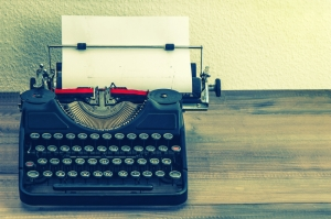 retro typewriter with white paper page. vintage style
