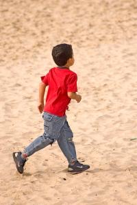 Boy in red shirt running